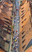 People Visit The Ancient Street At Kramerbruecke In Erfurt