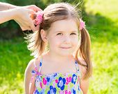 Sweet Smiling Little Girl With Her Mom's Hands Making Hairstyle (ponytail), Outdoor Closeup Portrait