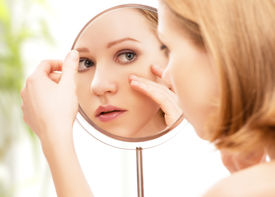 image of wrinkled face  - face of young beautiful healthy woman and reflection in the mirror - JPG