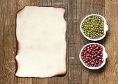 Raw Organic Azuki And Mung Beans And Old Paper