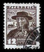 AUSTRIA - CIRCA 1934: A stamp printed by AUSTRIA shows Man from Upper Austria (Oberosterreich), Trad