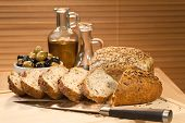 Fresh Cut Rustic Bread, Olive Oil & Green And Black Olives