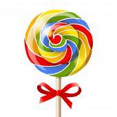 Bright colorful lollipop over white background