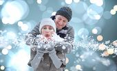 Mature winter couple against white glowing dots on blue