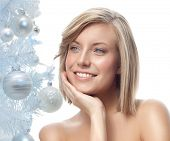 closeup portrait of attractive  caucasian smiling woman blond isolated on white studio shot lips toothy smile face hair head and shoulders  blue eyes tooth christmas tree new year baloons