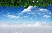 Composite image of snow falling against snowy landscape under blue sky