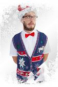 Geeky hipster in santa hat against christmas frame