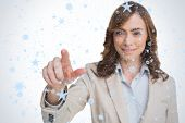 Portrait of businesswoman pointing her finger at camera against snow falling