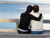 Daughter Showing Affection To Her Mother While At The Lake