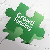Crowd Funding On Green Puzzle Pieces
