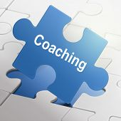Coaching Word On Blue Puzzle Pieces