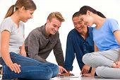 Group Of Multi-ethnic Friends Looking Digital Tablet