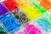 foto of loom  - Close up Colorful of elastic loom bands in box - JPG
