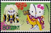 JAPAN - CIRCA 2000: A stamp printed in Japan shows Hello Kitty and Dear Daniel circa 2000