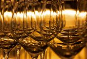 Empty wine glasses in golden backlight