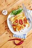 image of enchiladas  - Enchiladas with cream and red peppers on wooden table - JPG