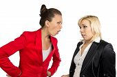 Two conflicted business women in office