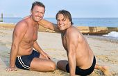 Two gay men on beach together