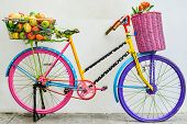 foto of gift basket  - flower and fruit in the basket on a colorful bicycle - JPG
