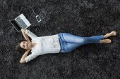 Young Woman Relaxing On The Carpet
