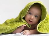baby in a towel after bathing