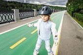 Cute Little Girl Learning Rollerskating