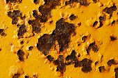 image of rusty-spotted  - rusty spots on the yellow faded metal - JPG