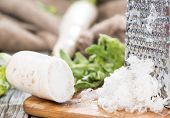 picture of grated radish  - Fresh grated Horseradish on dark wooden background - JPG