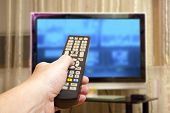 picture of controller  - Watching TV and using remote controller - JPG