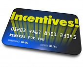Incentives word on a blue credit or gift card for rewards or bonus savings for buying or special per