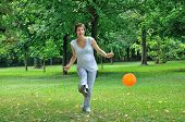Pregnant woman playing football