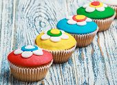 Cupcakes Covered With Mastic On A Wooden
