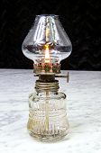 stock photo of kerosene lamp  - Cemetery kerosene lamp on a marble table - JPG