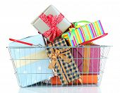 Metal basket full of present boxes isolated on white