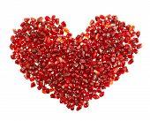Heart shape made of pomegranate seeds