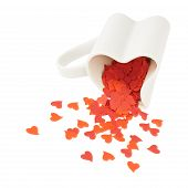 Heart confetti falling out of the cup
