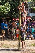 MYANMAR - JANUARY 4, 2014: Greasy pole climbing competition in village on Myanmar independence day