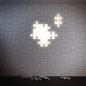 White puzzle wall without pieces