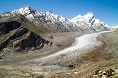 Glacier and the birth of the lake in Himalayas mountains