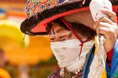 The Monk Performs A Religious Black Hat Dance During The Cham Dance Festival