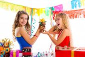 girl friends party excited with puppy chihuahua present dog in birthday