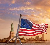 Statue of Liberty New York Manhattan and American flag background USA US