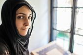 stock photo of eastern culture  - Arabic Muslim Middle Eastern girl reading Koran in Mosque - JPG