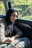 Arabic Muslim girl in the car traveling