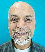 Senior Arabic Pakistani man studio portrait
