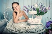 Girl with sweets on the table