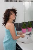 Woman In Bathroom Washing Her Hands With Soap