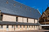 stock photo of assis  - famous hospice in Beaume France under blue sky - JPG