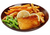 Breaded fried fillet and potatoes with asparagus and sliced lemon isolated on white