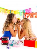 girl friends party kissing puppy chihuahua present dog in birthday